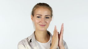 Jonge Vrouwelijke Student Clapping In Front Of White Background stock footage