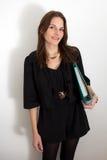 Jonge Vrouwelijke Student met een Omslag/een Bindmiddel Stock Foto