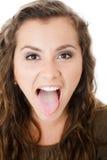 Jonge vrouwelijke tonende tong Royalty-vrije Stock Foto
