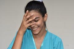 Jonge Vrouwelijke Verpleegster And Shyness Royalty-vrije Stock Fotografie