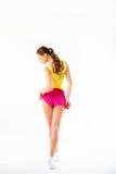Jonge vrouwengeschiktheid. Volledige lengte van terug in sportkleding op een wh stock afbeelding