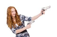 Jonge vrouwenmilitair met kanon Stock Foto