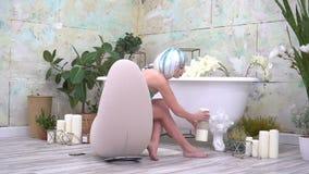 Jonge vrouwenzitting op ontwerperstoel in badkamers en holdings witte kaars stock footage