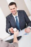 Jonge zakenman bij het gesprek Royalty-vrije Stock Foto