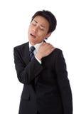 Jonge zakenman die aan stijve hals lijden Royalty-vrije Stock Fotografie