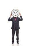 Jonge zakenman die een klok houden Stock Afbeelding