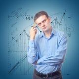 Jonge zakenman die in gedachten wordt verloren Stock Fotografie