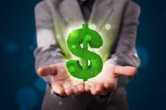 Jonge zakenman die groen gloeiend dollarteken voorstellen Stock Foto's