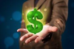 Jonge zakenman die groen gloeiend dollarteken voorstellen Royalty-vrije Stock Afbeeldingen