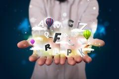 Jonge zakenman die magische wolken met brieven en bal voorstelt Royalty-vrije Stock Foto