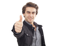 Jonge zakenman die O.K. teken met zijn omhoog duim tonen Stock Foto's