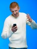 Jonge zakenman die op celtelefoon spreekt Stock Fotografie