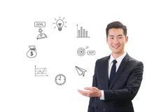Jonge zakenman die sociaal media & Internet-pictogramconcept tonen Royalty-vrije Stock Afbeeldingen