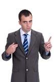 Jonge zakenman in een grijs kostuum die de verantwoordelijkheid a verwerpen stock foto's
