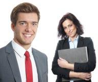Jonge zakenman met secretaresse Royalty-vrije Stock Afbeeldingen
