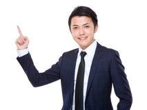 Jonge zakenman met vinger omhoog punt Stock Foto