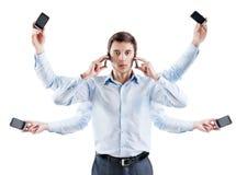 Jonge zakenman met zes handen en met telefoon Stock Fotografie