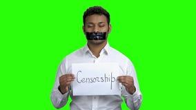 Jonge zakenman met zwarte band op mond stock video