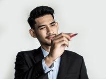 Jonge zakenman Pointing aan een doel royalty-vrije stock afbeeldingen