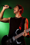 Jonge zanger op het overleg Stock Foto's
