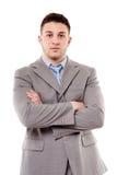 Jonge zekere zakenman met gevouwen wapens Stock Foto