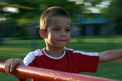 Jongen 3 van de speelplaats Stock Fotografie