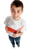 Jongen aan student met een boek stock foto