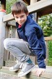 Jongen bij speelplaats Stock Foto