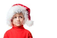 Jongen in de hoed van de Kerstman Stock Afbeeldingen