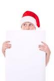 Jongen in de hoed van Kerstmis met een spatie Stock Foto's