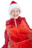 Jongen in de holding van de Kerstmishoed huidig over wit Stock Foto's