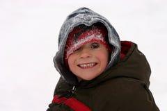 Jongen in de Sneeuw Stock Fotografie