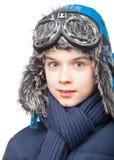 Jongen in de winterkleding stock foto's