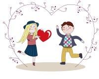 Jongen die aan meisje rood hart wordt voorgesteld Royalty-vrije Stock Foto's