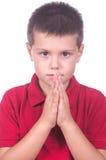 Jongen die 4 bidden Stock Foto