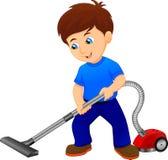 Jongen die de Vloer met Stofzuiger schoonmaken Stock Foto's