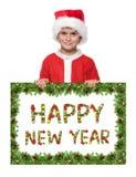 Jongen die een Kerstmisaffiche houdt stock afbeelding