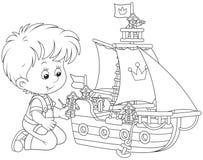Jongen die een stuk speelgoed schip spelen Royalty-vrije Stock Fotografie