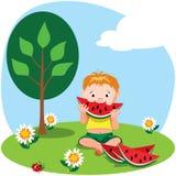 Jongen die een watermeloen eet Royalty-vrije Stock Foto's
