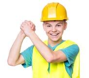 Jongen die gele bouwvakker dragen Royalty-vrije Stock Foto's