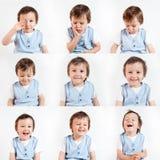 Jongen, die grappige gezichten op een witte achtergrond maken Stock Afbeeldingen