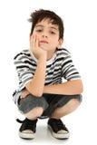 Jongen die met het Letten van op Uitdrukking rust stock afbeeldingen