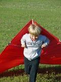Jongen die met Vlieger loopt Stock Afbeelding