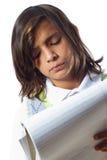 Jongen die Nota's neemt Stock Fotografie