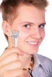 Jongen die sleutel toont Stock Afbeelding