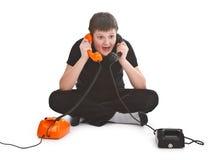Jongen die twee telefoongesprekken heeft Royalty-vrije Stock Foto