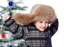 Jongen in een warme hoed Stock Foto's