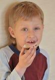 Jongen en Chocolade Stock Foto