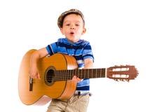 Jongen en gitaar Royalty-vrije Stock Foto's