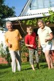 Jongen en grootouders Stock Foto's